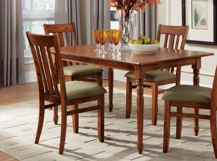 A kitchen table with four chairs around it